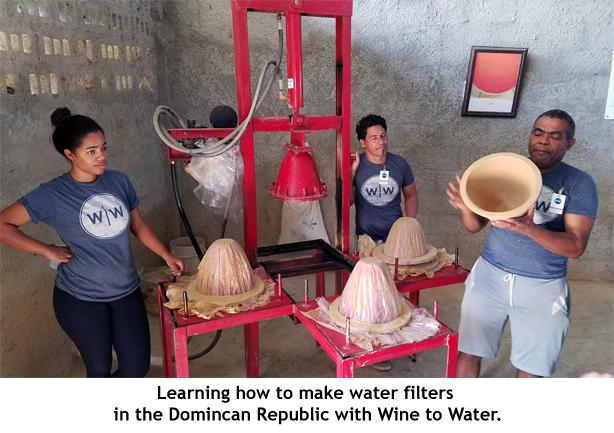 Locals teaching volunteers how to make water filters