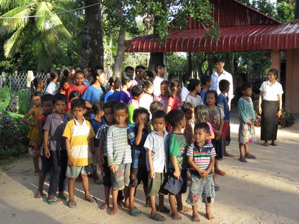 Kids outside of school in Cambodia