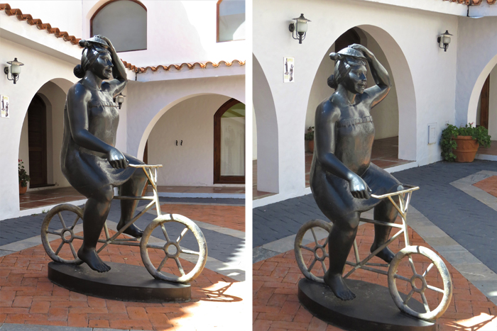 Sculpture of a woman on a bike