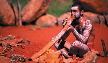 Australian Aboriginal playing the didgeridoo
