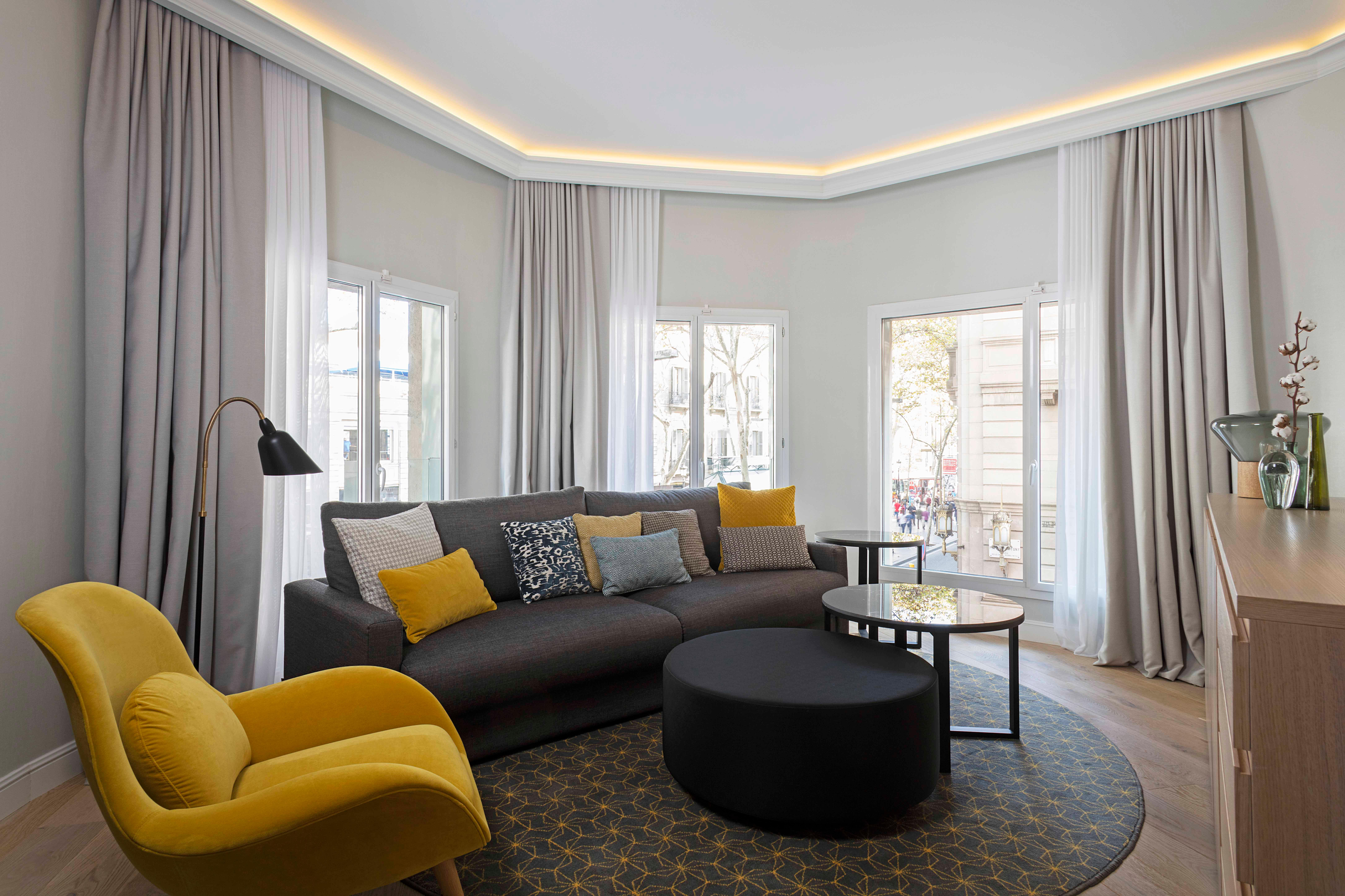 Corner Suite-Plug into the energy of Barcelona's most iconic boulevard. The Corner Suite overlooks the Ramblas, bringing its brio into a generous, sophisticated space inspired by Mid-Century Modernism.