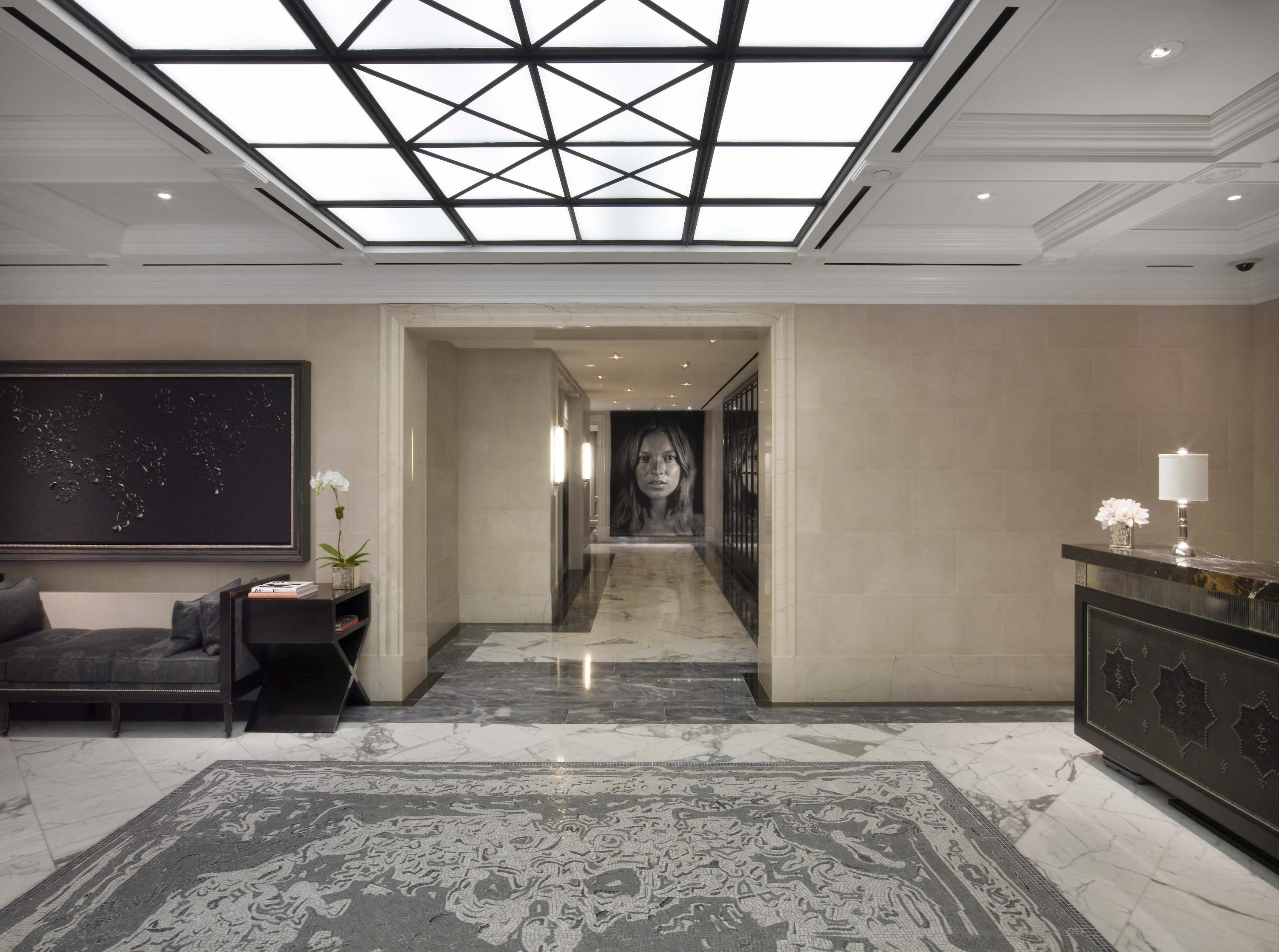 Lobby- featuring mosaic area rug and tapestry by Chuck Close